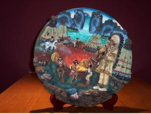 Circular Plate showing leader watching his community celebrating. Issued by Midori Mint, Limited Edition