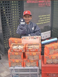 Bilaal selling cookies to aid the Haiti hurricane victims