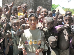 Bilaal with children in Malawi