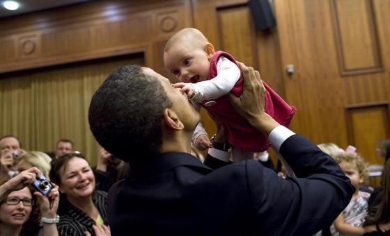 President Obama lifts a baby during his recent trip to Europe. White House Photo, by Pete Souza