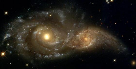 A grazing encounter between two spiral galaxies. Billions of years in the future, these galaxies will collapse into one larger galaxy. It is believed that most galaxies are formed in this way. NASA Photo
