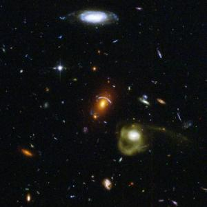 Like a photographer clicking random snapshots of a crowd of people, NASA's Hubble Space Telescope has taken a view of an eclectic mix of galaxies. In taking this picture, Hubble's Advanced Camera for Surveys was not looking at any particular target. The camera was taking a picture of a typical patch of sky, while Hubble's infrared camera was viewing a target in an adjacent galaxy-rich region. Photo Credit NASA/ESA