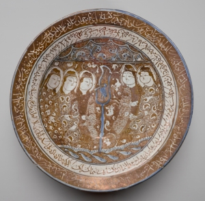 Beginning in the twelfth century, ceramics were produced in Iran with a frit body that provided a clean, light surface for painting. The most luxurious of these wares contained luster, added to the surface in a second firing and creating a metallic sheen that complemented mystical texts and images. While the image on this dish does not appear to be narrative, the presence of a bird, a familiar theme in Persian mystical literature, and certain human features associated with light (such as the figures' moon-shaped faces) set the tone for the mystical verses appearing in two bands around the rim and interior. The text includes poetry by Rumi's spiritual master, Shams al- Din Tabrizi (d. 1248), as well as verses believed to have been composed by the lesser-known Baba Afzal al-Din Kashani (d. 1213–14).