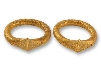 Gold bracelets decorated with embossing and fine filigree work.