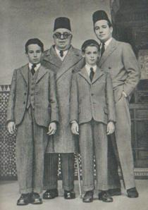 The Aga Khan pictured with his son, Prince Sadruddin, and grandsons Prince Karim (left) and Prince Amyn