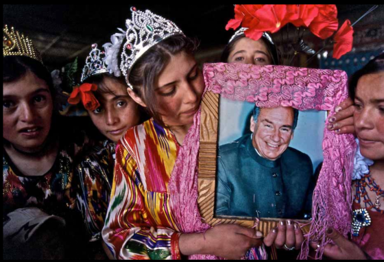 Ismaili girls in Central Asia proudly and lovingly display a decorated frame holding a photo of their beloved 49th Imam, His Highness the Aga Khan. Please click for enlargement. Photo: Matthieu Paley. Copyright.