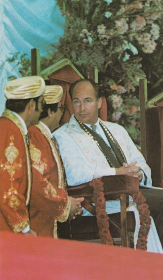 Mawlana Hazar Imam pictured at the Olympia Hall, London, during his weeklong visit to the United Kingdom Jamat in September 1979. Seated next to him on the stage are Mukhi Noordin Jivraj and Kamadia Nizar Dhanani. Photo: Jehangir Merchant Collection.