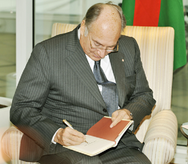 "His Highness Aga Khan signing his book ""Where Hope Takes Root"" for the Premier of British Columbia during his 2008 visit to the province to celebrate his Golden Jubilee. Ismailis will be celebrating his 57th Imamat Day on July 11, 2014. Please click on image for Imamat article. Photo: With permission of The Vancouver Sun. Copyright."