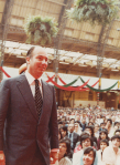 Mawlana Hazar Imam amidst his murids at the Olympia Hall during his visit to the United Kingdom jamat in September 1979. Photo: Jehangir Merchant Collection.