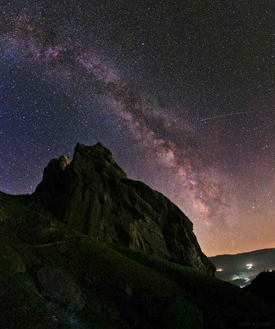 The arc of the Milky Way hangs over the imposing mountain fortress of Alamut in this starry scene. Photo: Babak Tafreshi. Copyright.