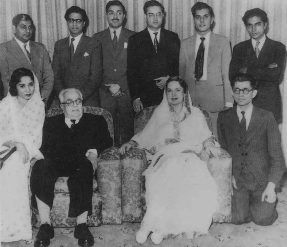 Standing L-R: Mohamed Teja (Nairobi, Kenya), Amir Aly Karim (accountant), Mohamed Jaffer (lawyer, Vazir Chhotubhai's son, Pakistan), Late Shamshudin Jaffer Ladak (Dodoma), Individual name Not available, and youthful Abdul Mamdani. Sitting L-R: Mrs. Shirin Esmail (lawyer, Uganda), Mawlana Sultan Mahomed Shah (His Highness the Aga Khan), Mata Salamat Om Habibeh Begum Aga Khan, Zool Nimji Javeri (Kamadia, London). Photo: Abdul Mamdani Collection.