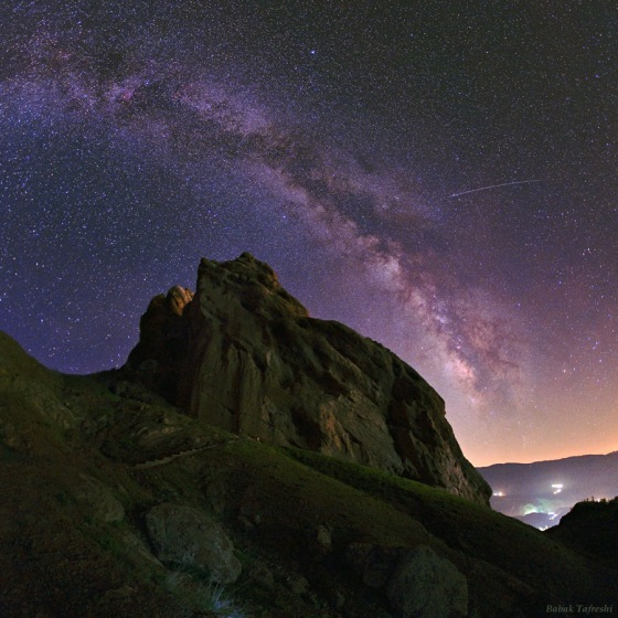 As seen on NASA's Astronomy Picture of the Day and the National Geographic News a meteor's streak and the arc of the Milky Way hang over the imposing mountain fortress of Alamut in this starry scene. Photo: Babak Tafreshi/Dreamview.net . Copyright. Please click on image to listen to BBC program Core.