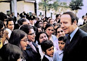 Prince Sadrudin Aga Khan pictured with Ugandan Asian refugees at the Naples refugee centre. Photo: Vali Jamal Collection. Copyright.