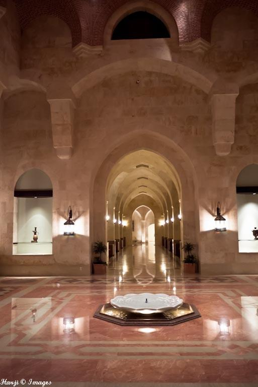 A view of the main entrance hall of the Ismaili Centre, Dubai draws architectural inspiration from the Fatimid mosques in Cairo. At the centre of the colourfully patterned marble floor is an ornamental fountain crafted from a solid block of Carrara marble. Photo: Muslim Harji, Montreal, PQ. Copyright. See link 6.