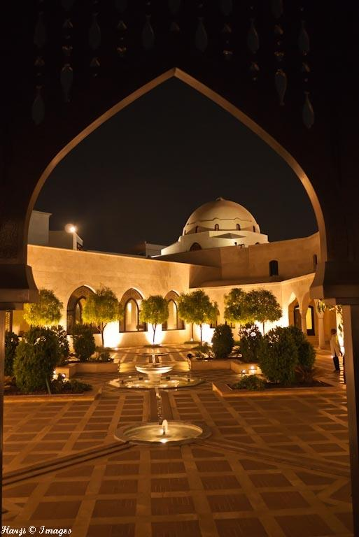 Ismaili Centre, Dubai. The patterns, fountains and flower beds draw upon various traditions from across the Islamic world. The building is crowned by a magnificent Ibn Tulun Mosque-like dome. Photo: Muslim Harji, Montreal, PQ. Copyright. See link 6.