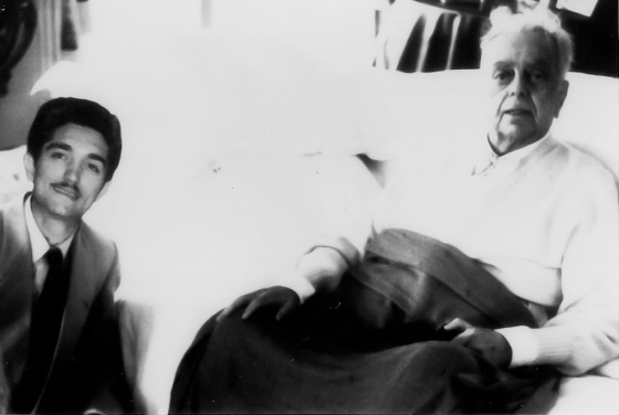 """The late Sir Sultan Mahomed Shah Aga Khan III pictured with Badrudin Adatia. Recalls Adatia: """"I wanted to take picture of him with us and I asked his permission. The room was dim, however, and I didn't have a flash on my camera. Although he was very sick and could not even walk, he told me he would head toward the window where there would be better light. Imagine! I clasped my hands with respect and said, """"No Khudavind. I will take the picture just as we are."""" Photo: Badrudin Adatia collection."""
