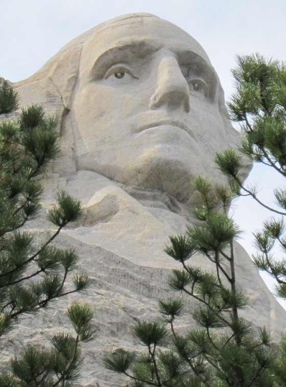 The colossal face of  George Washington as photographed from the Presidential Trail at the Rushmore Memorial. George Washington (1732 - 1799), America's first President is considered the father of the country and is therefore the most prominent figure on the mountain. Photo: Malik Merchant. © Simerg.com