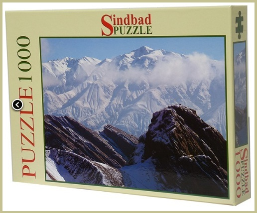 The box set containing the 1000 Jigsaw Puzzle pieces for the Rock of Alamut, manufactured by Sindbad Puzzle. Image: Nadir Mackwani, Founder and Manager. Website: http://www.sindbad-puzzle.com