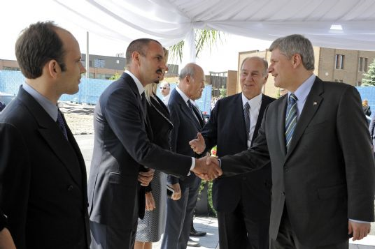 His Highness the Aga Khan presents Prince Rahim Aga Khan to Canadian Prime Minister Stephen Harper at the Foundation Ceremony of the Aga Khan Museum and the Ismaili Centre being constructed in Toronto. Photo: Gary Otte. Aha Khan Development Network.