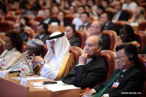 "His Highnes the Aga Khan, second from right, gave the keynote address at the International Conference on ""Culture: Key to Sustainable Development"" in Hangzhou, capital of East China's Zhejiang Province, May 15, 2013. Photo: Xinhua/Xu Yu. See http://www.globaltimes.cn/content/781768.shtml"