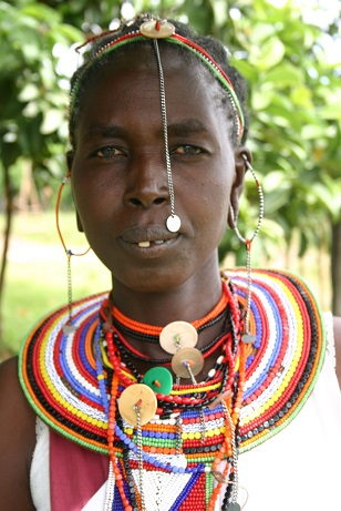 A Kenyan Maasai woman's pride, the emankeeki, neck-to-chest body décor in patterned beads . Photo: Shana Greene, http://www.villagevolunteers.org. Copyright.