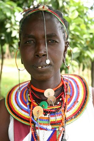 A Kenyan Maasai woman's pride, the emankeeki, neck-to-chest body décor in patterned beads . Photo: Shana Greene, http://www.villagevolunteers.org. Copyright.
