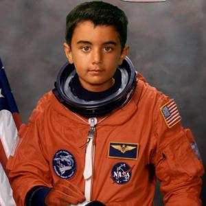 Qayl dressed as an astronaut. Please click on photo to read Qayl's photo essay.