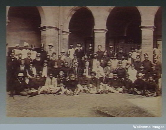 A group of people who worked as volunteers during the plague epidemic in Bombay. Photograph attributed to Captain C. Moss, 1897.