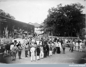 A group comprising doctors, health and public officials gathered on a street in Bombay about to begin the day's work, during an outbreak of plague. Photo Credit: Wellcome Library, London. Wellcome Images. Copyright.