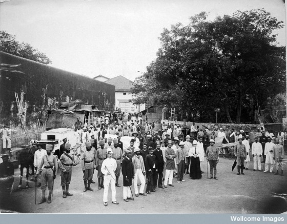 A group comprising doctors, health and public officials gathered on a street in Bombay about to begin the day's work, during an outbreak of plague. Photo Credit: Wellcome Library, London. Wellcome Images. Copyright. Please click on image for excerpts by His Highness the Aga Khan