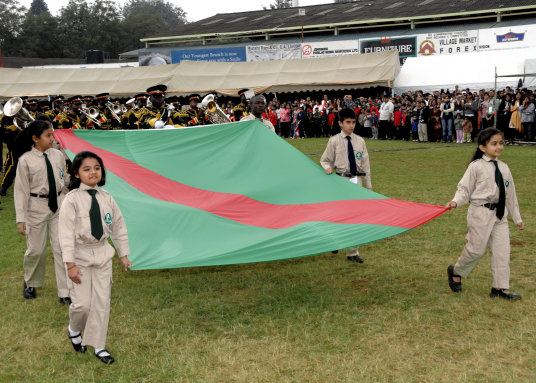 Young Ismaili girls and boys carry the Ismaili Flag with pride during the Golden Jubilee Games held in Kenya to commemorate the 50th Imamat anniversary of His Highness the Aga Khan. Photo: The Ismali/Moez Visram (Hakim Sons)
