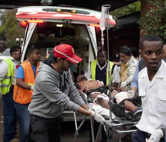 An injured person is brought to the Aga Khan Hospital in Nairobi after an attack at a mall in the Kenyan capital. Please click for a slide show and photos at the Denver Post.