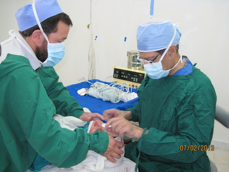 Badrudin Kurwa, right, performing a cataract surgery in Chitral, Pakistan. Please click on image to read article.