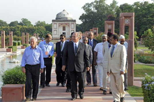 Mawlana Hazar Imam, accompanied by Prince Hussain and officials from the Aga Khan Trust for Culture, including its General Manager, Luis Monreal, front left, walks down the central axis of the Sundar Nursery — once known as Azim Bagh (great garden) —after visiting  the Sundar Burj, a 16th century tomb restored by the AKTC. Photo: AKDN/Gary Otte