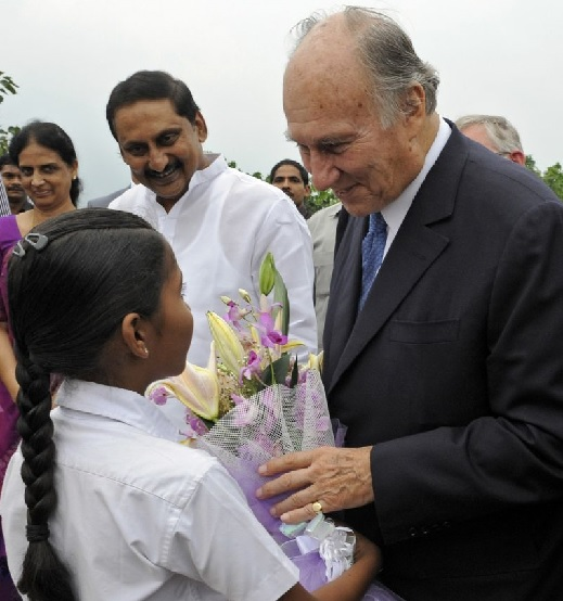 A young girl presents Mawlana Hazar Imam with flowers on the occasion of the inauguration of the Aga Khan Academy,  Hyderabad. Photo: The Ismaili/Gary Otte.