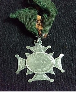 A 'Badge of Honour' presented to the Ismaili Scout Band in Daman in the 1940's.