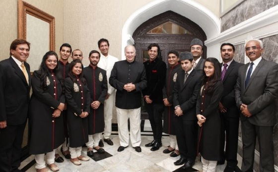 Mawlana Hazar Imam poses for a photograph with the performers at the conclusion of the institutional dinner. Photo: The Ismaili/Aziz Ajaney.