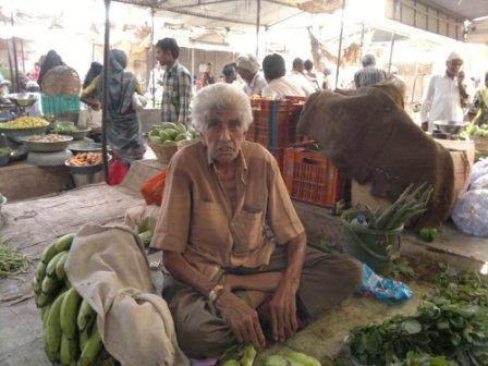Gulamhusen at his vegetable stall at a market in Mahuva.