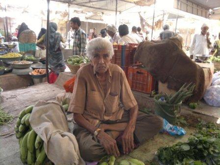 Gulamhusen at his vegetable stall at a market in Mahuva.