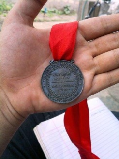 A Volunteer Day medal for Gulamhusen Jamani who has served the Jamat since childhood.