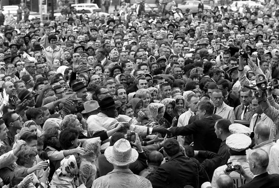 22 November, 1963: President Kennedy reaches out to the crowd gathered at the Hotel Texas Parking Lot Rally in Fort Worth, TX. Photo credit: Cecil Stoughton/John F. Kennedy Presidential Library and Museum, Boston. Please click on image for article and more photos.