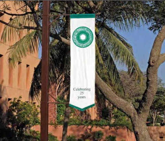 The Aga Khan University Seal on a banner flying to commemorate the 25th Anniversary of the University in 2008. Photo: Aga Khan Development Network.