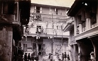 V0029869 A plague house being whitewashed by men standing on scaffold