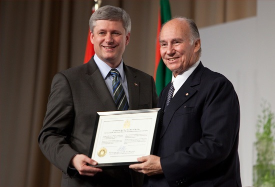 On June 19, 2009,  the House of Commons voted unanimously to bestow Honorary Canadian citizenship on his Highness the Aga Khan. Prime Minister Stephen Harper is seen here presenting the Ismaili Imam with the  Citizenship during the foundation ceremony in Toronto of the Aga Khan Museum, the Ismaili Centre and their Park. Photo: The website of the Prime Minister of Canada.