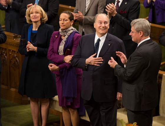 An expression of gratitude and humility by His Highness the Aga Khan as he accepts a standing ovation at the Canadian Parliament on Thursday February 24, 2014. Prime Minister Stephen Harper is seen applauding, with Princess Zahra, the daughter of His Highness, and Laureen Harper, the Prime Minister's wife, standing alongside the 49th Ismaili Imam. Photo credit: The Office of the Prime Minister of Canada