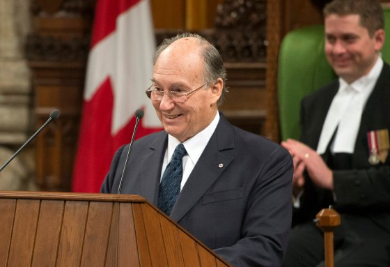 "His Highness the Aga Khan seen smiling in a lighter moment  during his address to both the Houses of the Canadian Parliament on Thursday, February 27, 2014. Referring to the two gold medals won by the Canadian hockey teams in the Sochi Olympics, the Ismaili Imam remarked, ""As an ex-player myself I was hoping you would require your honorary citizens to join your team. I am convinced that the Dalai Lama and I would have been a formidable defence.  Photo credit : The Office of the Prime Minister of Canada."