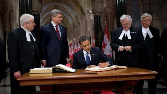 President Barack Obama signs the guest book in Parliament Hill during his visit to Ottawa shortly after becoming the US President. Prime Minister Stephen Harper is standing to President Obama's right. Photo: Whitehouse.