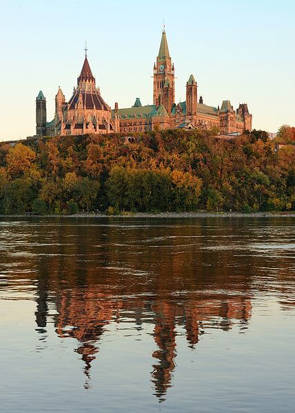 Photo of the Centre Block and Library of the Parliament of Canada from the Gatineau side, overlooking the Ottawa River. Photo: Wikipedia.