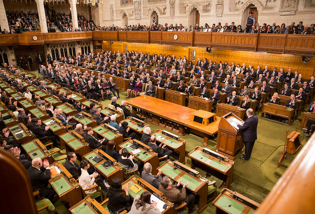 His Highness the Aga Khan seen addressing at the House of Commons Chambers to both the houses of Canadian Parliament on Thursday, February 24, 2014. Photo credit: The Office of the Prime Minister of Canada.