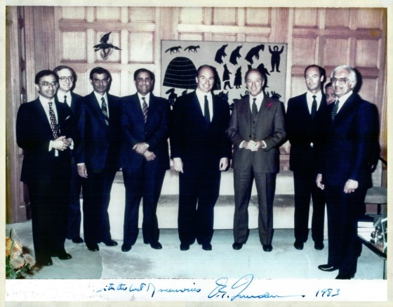 A unique and historical photo signed by the late Canadian Prime Minister, Pierre Trudeau, which was taken in the Prime Minister's Office during Mawlana Hazar Imam's Silver Jubilee visit to Canada in April 1983.  (l to r) -  Hon. Sec Farouk Verjee (National Council), Mr. Gerry Wilkinson (His Highness the Aga Khan's Secretariat, Aiglemont, France), Hon. Sec Mohamed Manji (Ontario Council), President Amirali Rhemtulla (Grants Council), Mawlana Hazar Imam, Prime Minister Pierre Trudeau, Prince Amyn Muhammad Aga Khan, President Mehboob Dhanani (Ontario Council) and President Zulficar Lalji(National Council). Canada. The full signature line note from the Prime Minister read:  To Farouk with the best of Memories . Trudeau. 1983. Photo: Photo: Farouk Verjee Collection, Vancouver,